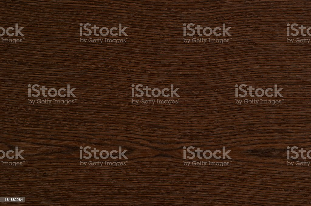 Background image of a dark stained wood surface royalty-free stock photo