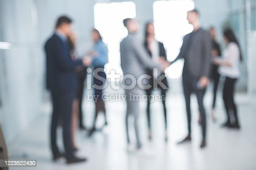 background image of a group of business people in the office lobby. business background