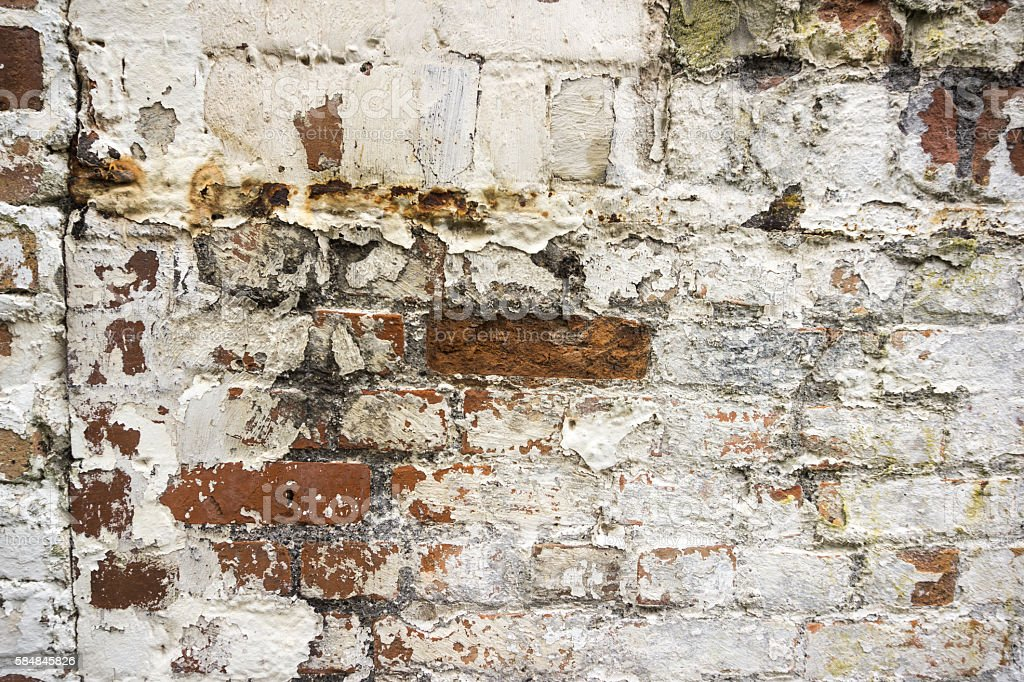 Background image of a whitewashed old brick wall stock photo