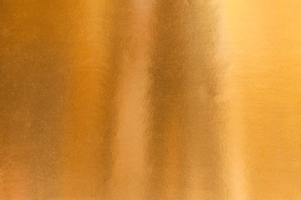 a background image of gold paper - foil stock photos and pictures