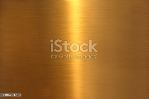 golden colored abstract close up brushed metal surface texture