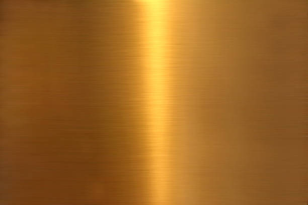 background image of golden colored brushed metal surface texture stock photo