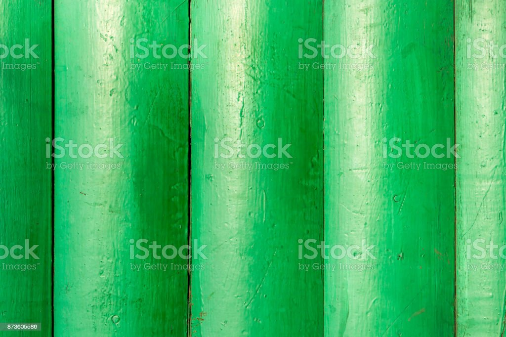 A background image of green painted wood stock photo