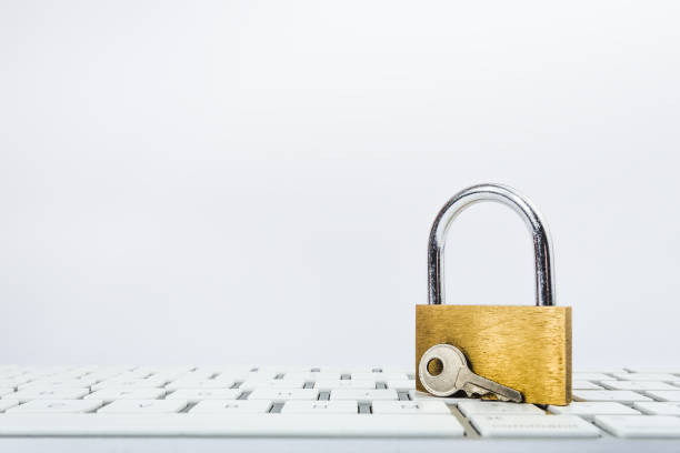 background image of metal lock on keyboard - privacy policy stock photos and pictures