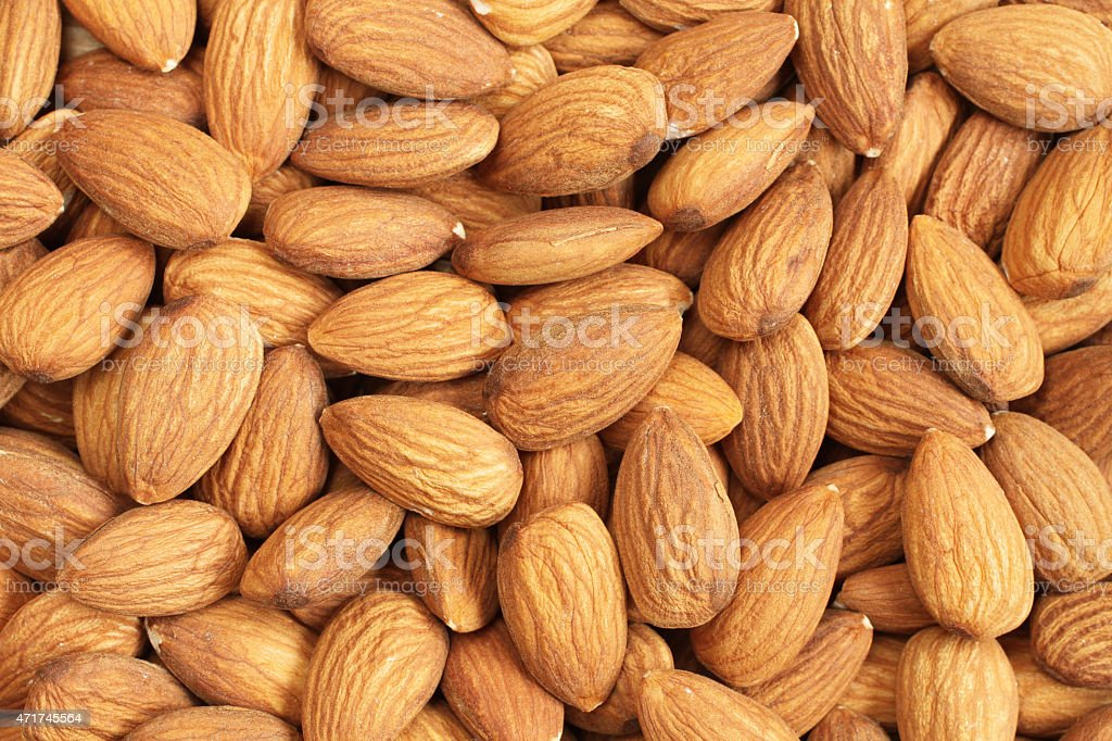 Background image of raw almond nut meats stock photo
