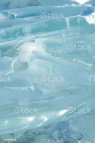 Photo of Background image of transparency blue ice pan in stacked layer.