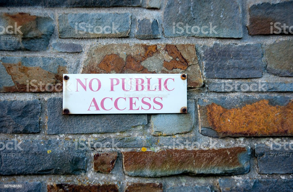 Background image Old stone wall with No public access sign stock photo