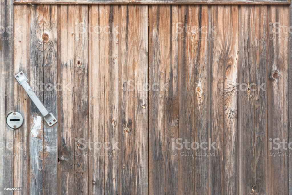 Background in style a rustic from old vertical wooden unpainted boards with the handle стоковое фото