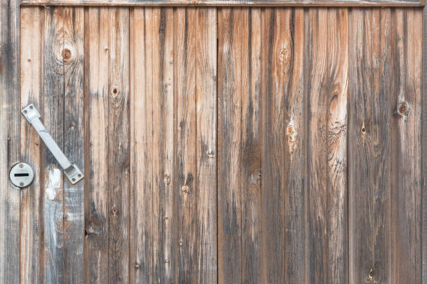Cтоковое фото Background in style a rustic from old vertical wooden unpainted boards with the handle