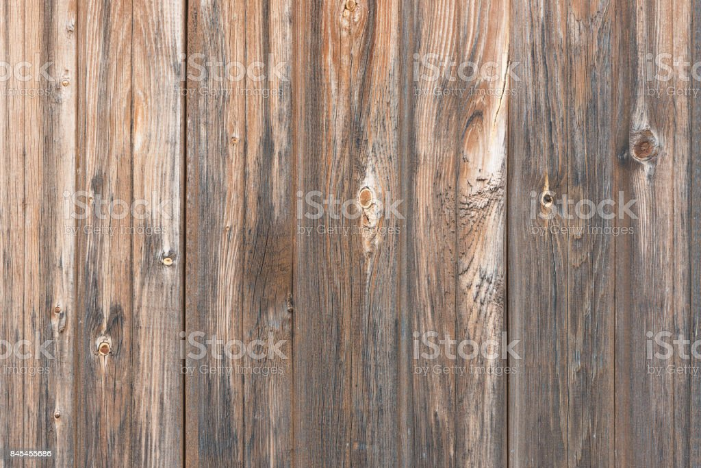 Background in style a rustic from old wooden unpainted boards with knots стоковое фото