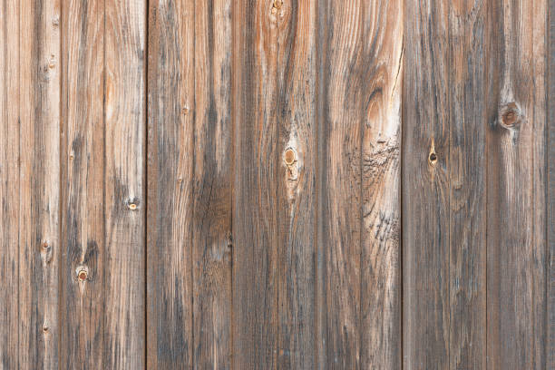 Cтоковое фото Background in style a rustic from old wooden unpainted boards with knots