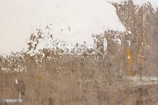 639291528istockphoto background in the process of updating gray concrete walls with putty 1192815176