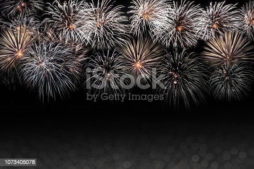 istock Background New Year's texture black with salute, fireworks. 1073405078