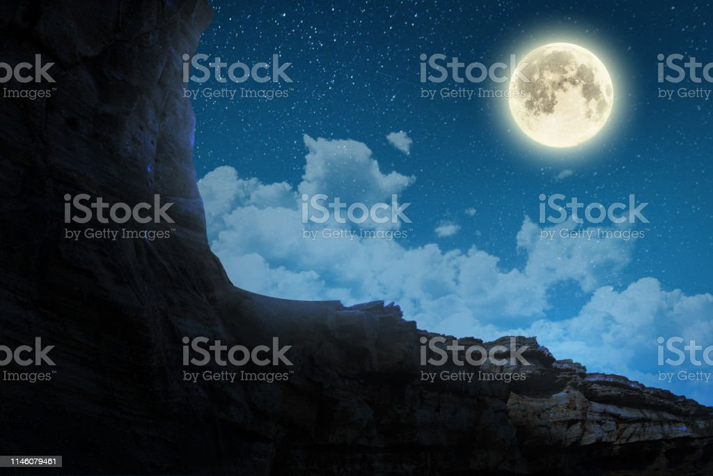 background night sky with stars, moon and clouds.