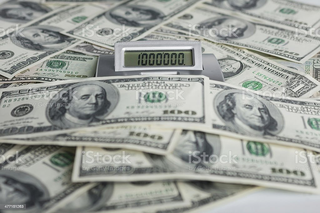 Background of $ 100 bills and a calculator stock photo