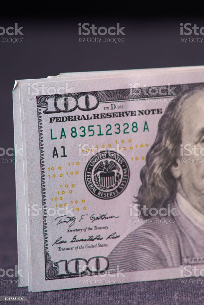 Background of 100 dollar bills. a pile of American paper hundred-dollar bills as an element of the world financial system stock photo