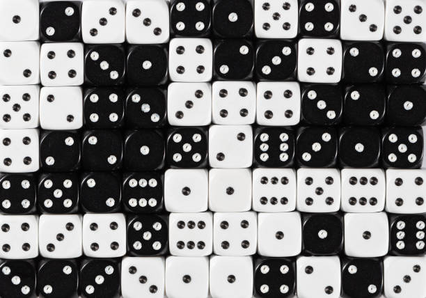 Background of 70 random ordered black and white dices Pattern background of 70 random ordered black and white dices arbitrary stock pictures, royalty-free photos & images