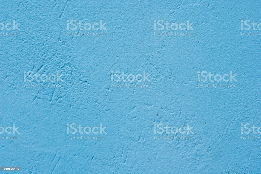 Background of a blue painted cement wall, rough cast of cement and concrete wall texture, decorative rustic coating stock photo