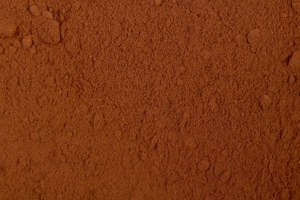 Background of a dry powder cocoa Background of a dry powder cocoa. Hi res photo. cacao fruit stock pictures, royalty-free photos & images
