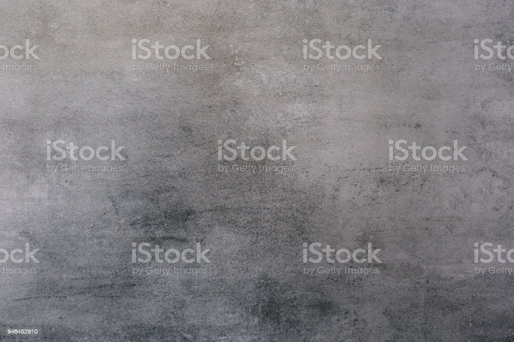 Background of a gray stucco coated and painted exterior, rough cast of cement and concrete wall texture stock photo