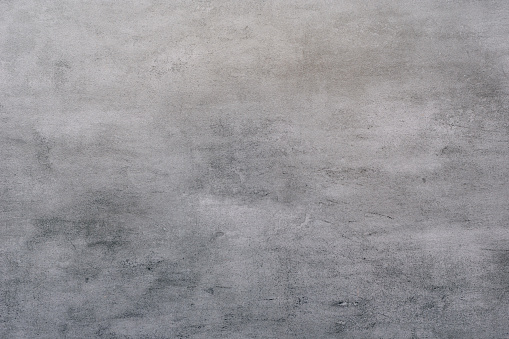 Background of a gray stucco coated and painted exterior, rough cast of cement and concrete wall texture
