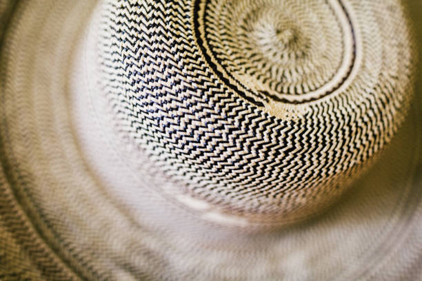 Background of a handmade palm leaf hat, as seen in one of Panama City markets. stock photo