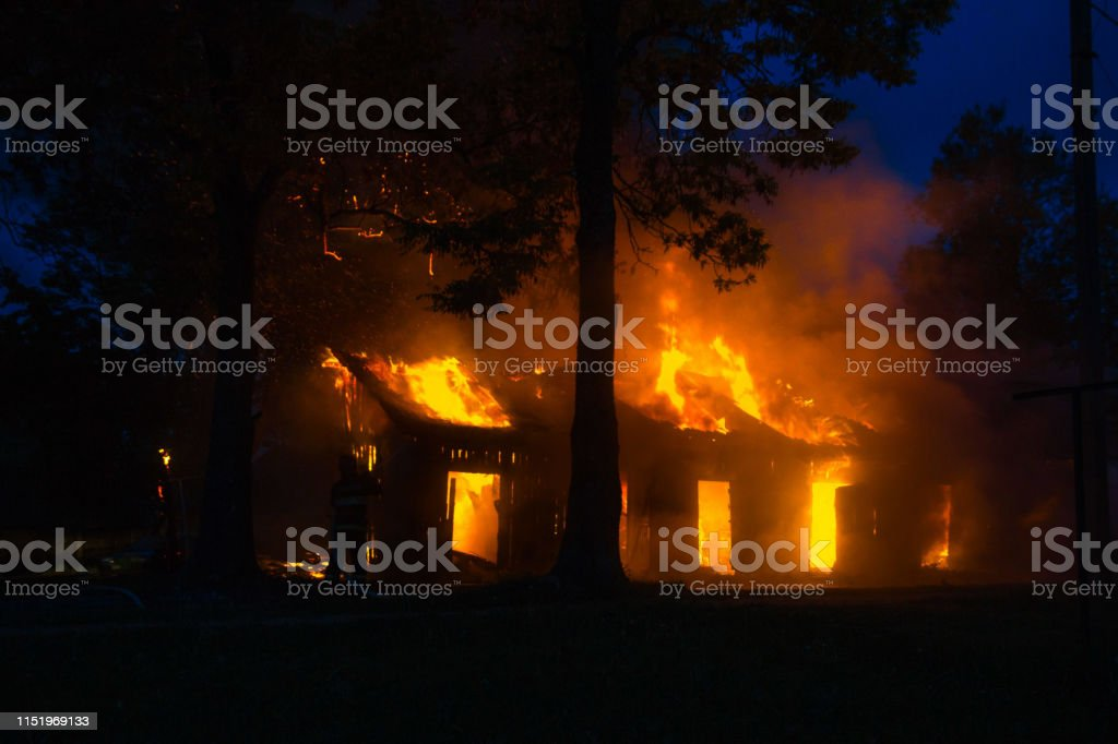 background of a house fire in the forest. natural disasters