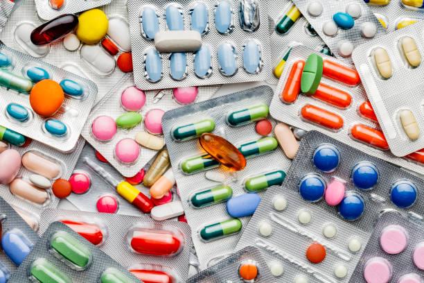tło dużej grupy różnych kapsułek, tabletek i pęcherzy - kapsułka zdjęcia i obrazy z banku zdjęć