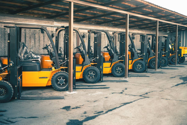 Background of a lot of forklifts, reliable heavy loader, truck stock photo