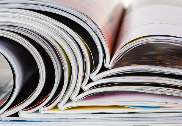 background of a pile of old magazines with bending pages - publication stock pictures, royalty-free photos & images