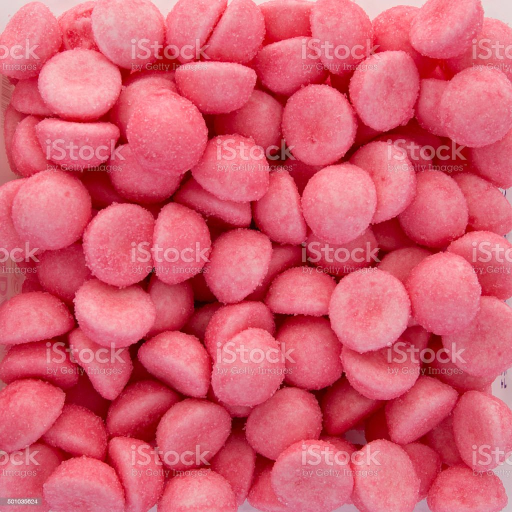 Background of a pink strawberries candies stock photo