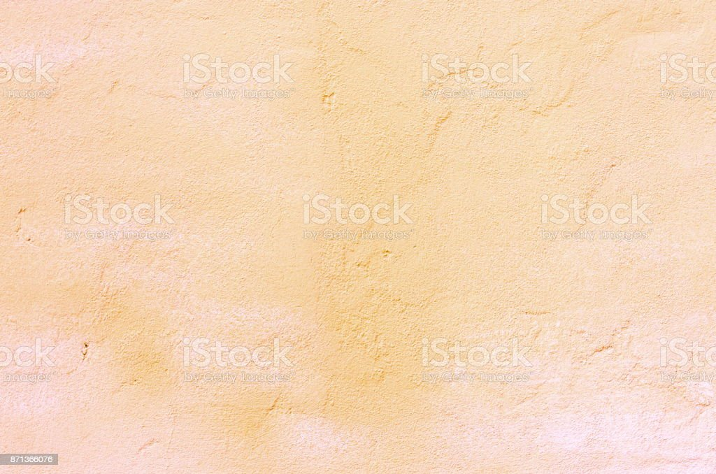 Background of a pink stucco coated and painted exterior, rough cast of cement and concrete wall texture, decorative coating stock photo