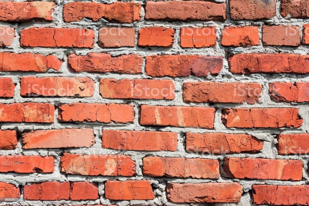 background of a red brick wall zbiór zdjęć royalty-free