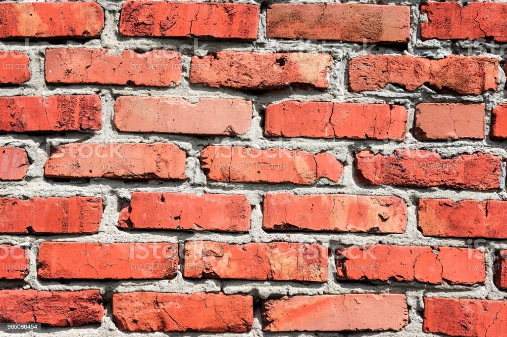 background of a red brick wall zbiór zdjęć royalty-free