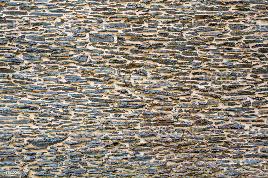 Background of a smooth old exterior stone wall wallpaper stock photo