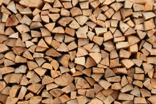 Background of a stack of firewood in various brown tones