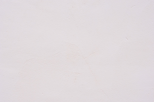 Background of a white stucco coated and painted exterior, rough cast of cement and concrete wall texture, decorative rustic coating