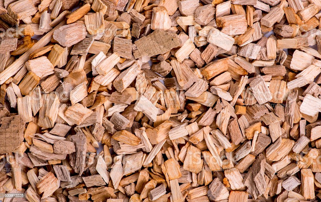 Background of alder wood chips close up stock photo