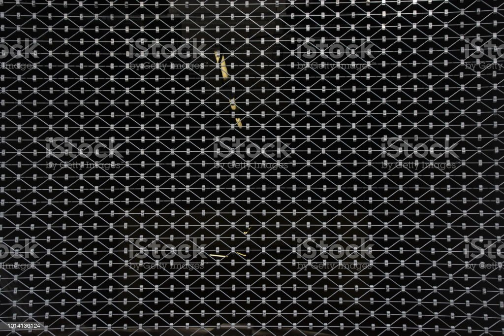 Background of an iron mesh against a black background stock photo