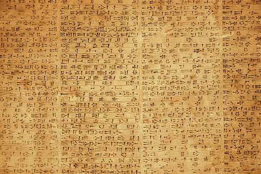 Background of ancient Babylonian or Persian cuneiform symbols on rock tablets