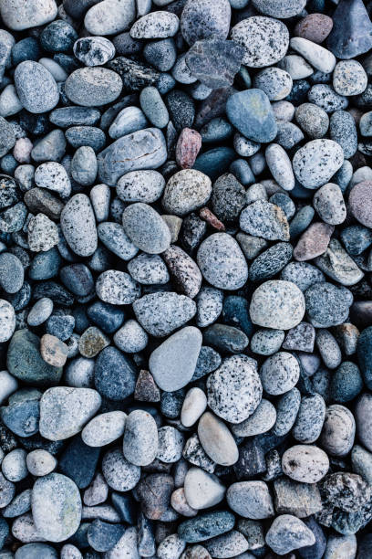 Background of assorted river rocks stock photo