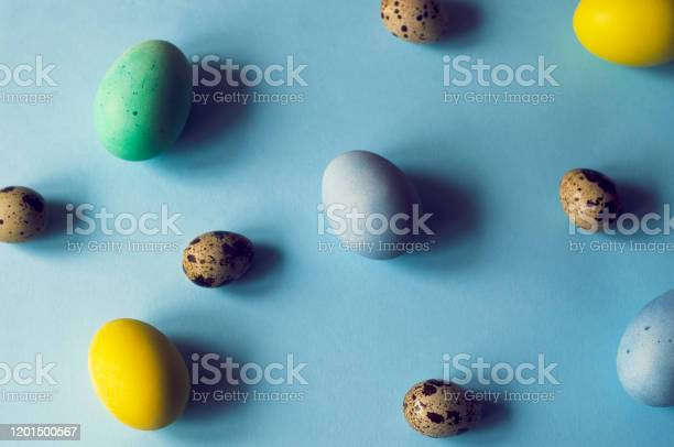 Background of blue color with multicolored eggs of different sizes picture id1201500567?b=1&k=6&m=1201500567&s=612x612&h=dr3bxzadojds7bvgdgdc3142iysdqbknrewfyi5vn3w=