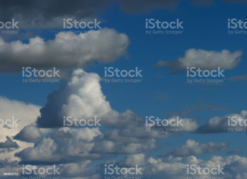 Background of blue sky with white fluffy clouds stock photo