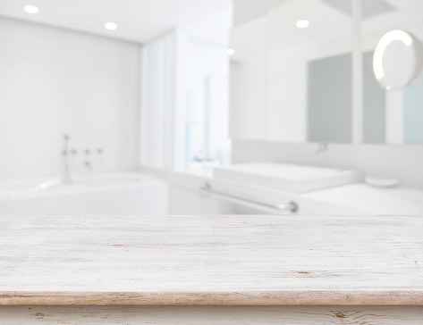 istock Background of blurred bathroom interior with wooden table in front 685470232