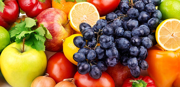 background of bright fruit and vegetables - onion juice stock photos and pictures