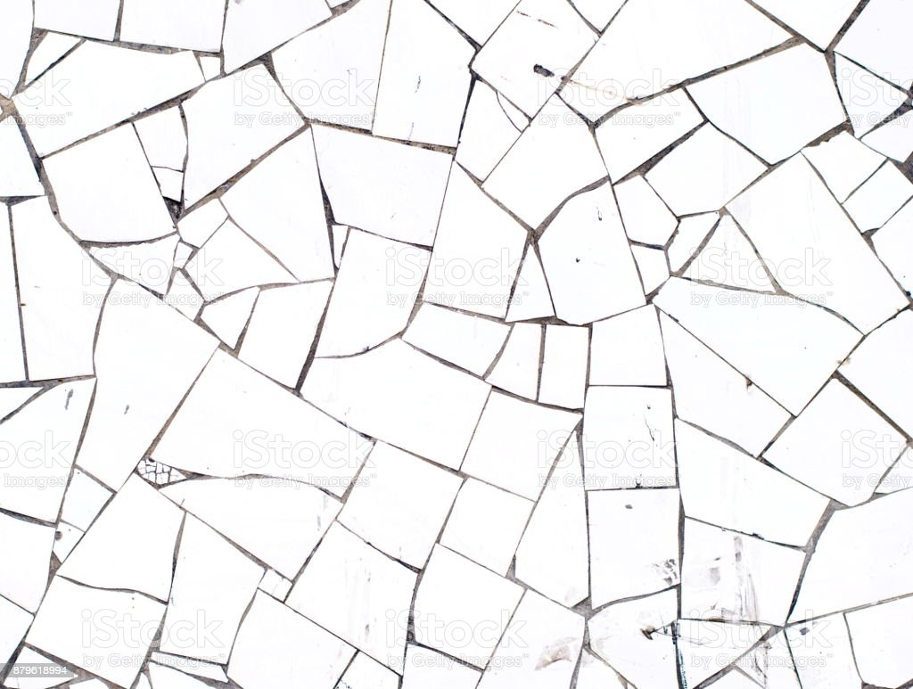 Background Of Broken White Mosaic Tiles Wall Texture Royalty Free Stock Photo