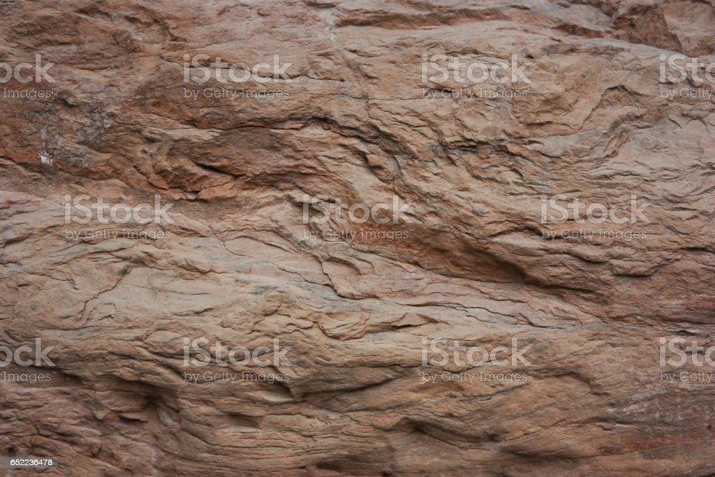 Background of brown, red ,foliated stones in a chaotic manner stock photo