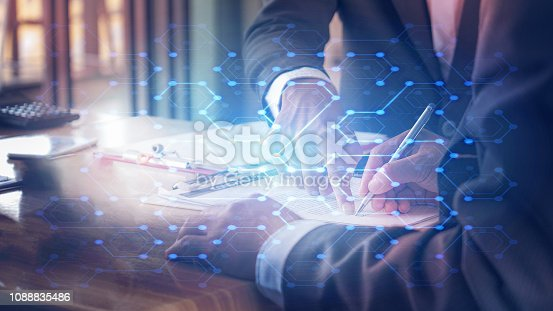 istock background of businessman signing contract with attorney with abstract foreground of digital symbol 1088835486