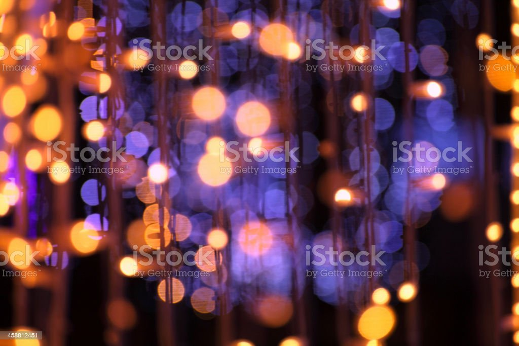 Background of Christmas light bokeh in violet and gold stock photo