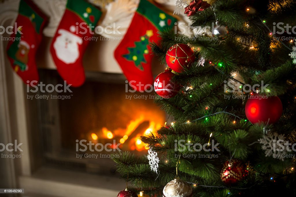 Background of Christmas tree at living room with burning firepla stock photo